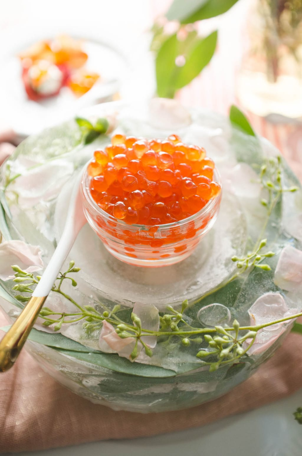 Salmon roe and floral ice bowl Valentine's Day appetizer party table via @thouswellblog