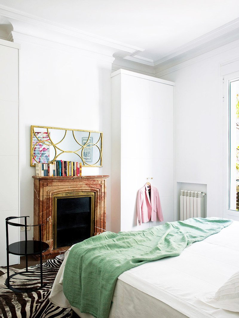 Simple bedroom with marble fireplace via @thouswellblog