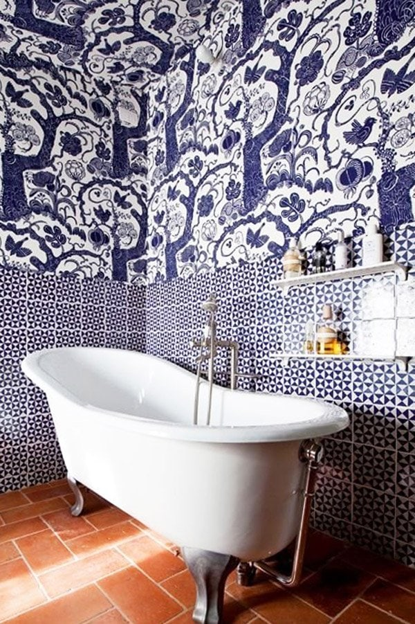Blue and white bathroom with tiles on every surface and a free-standing tub via @thouswellblog