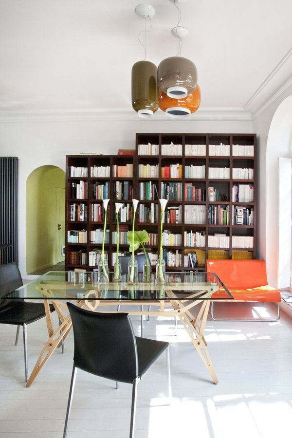 Bright, modern French dining room with bookcase and glass-top table via @thouswellblog