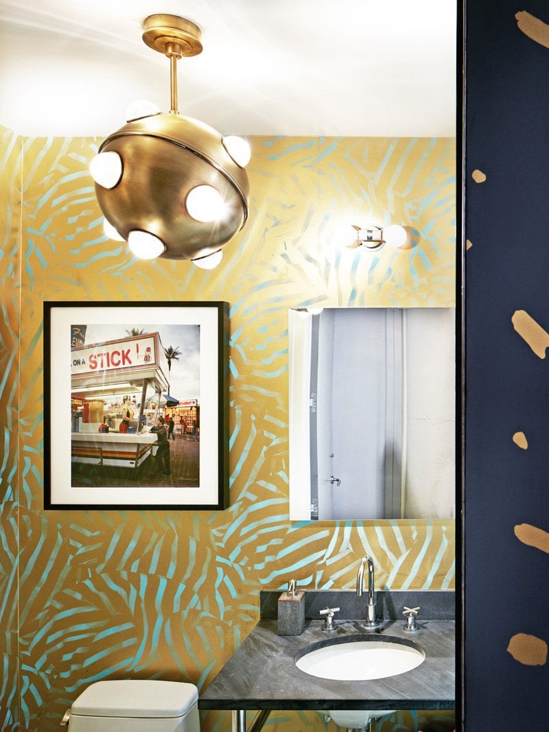 Gold wallpaper with Jonathan Adler light fixture in the bathroom via @thouswellblog