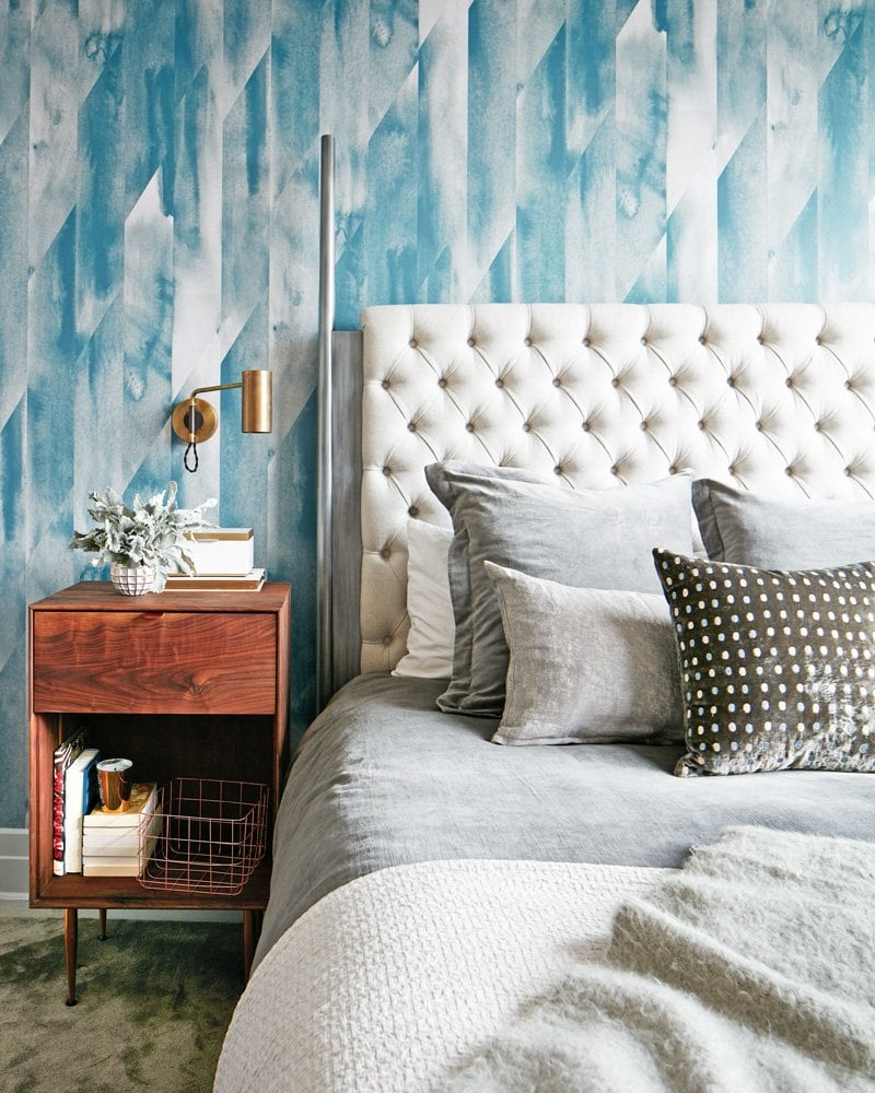 Blue accent wall wallpaper with neutral bed in master bedroom via @thouswellblog