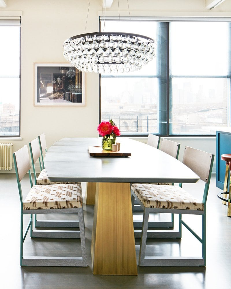 Modern family dining room table with glass chandelier via @thouswellblog