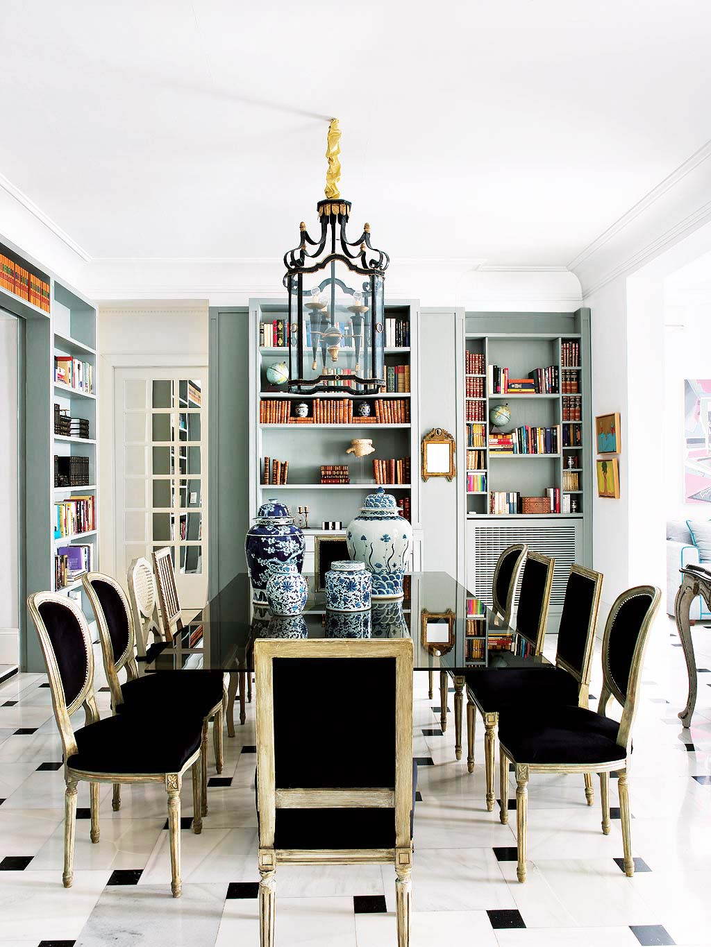 Dining room with blue bookshelves in the dining room via @thouswellblog