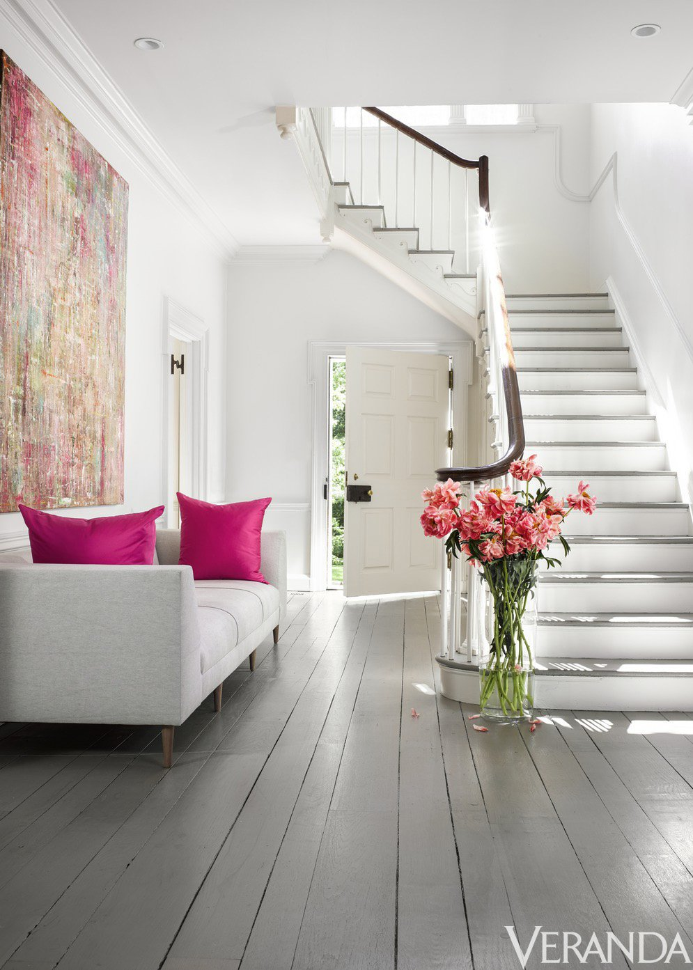 White entry with grey floors and pink accents via @thouswellblog