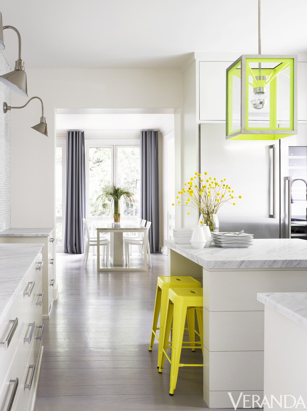 White kitchen with bright yellow accents via @thouswellblog