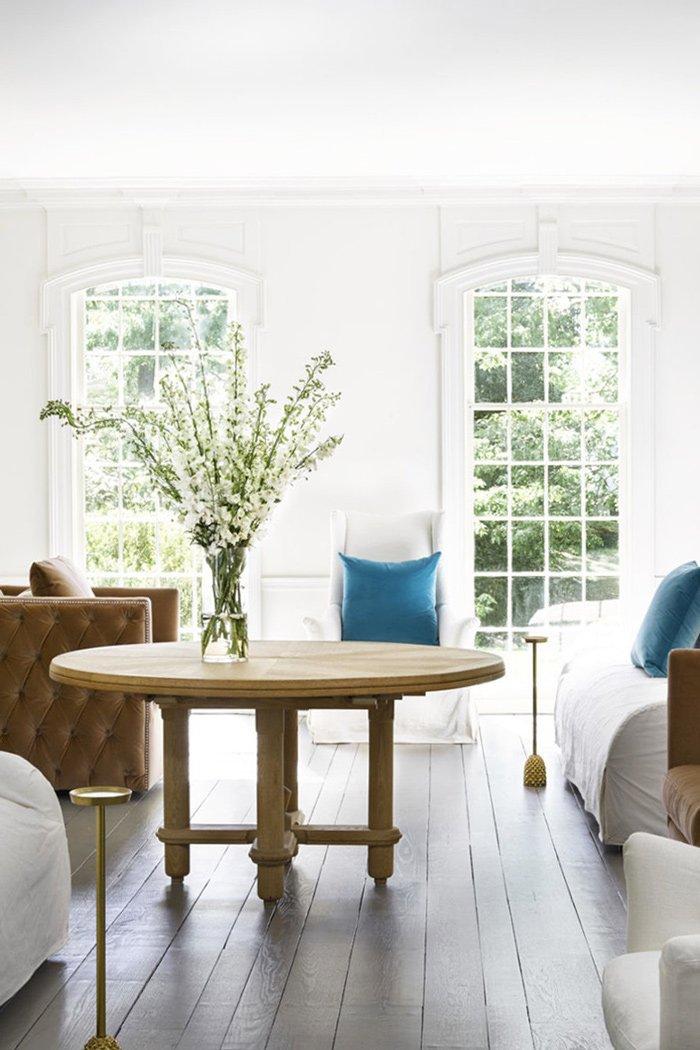 Modern living room with white sofas, teal pillows, grey floors via @thouswellblog