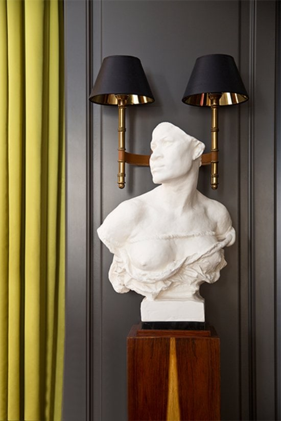 Marble bust with mid-century sconce via @thouswellblog