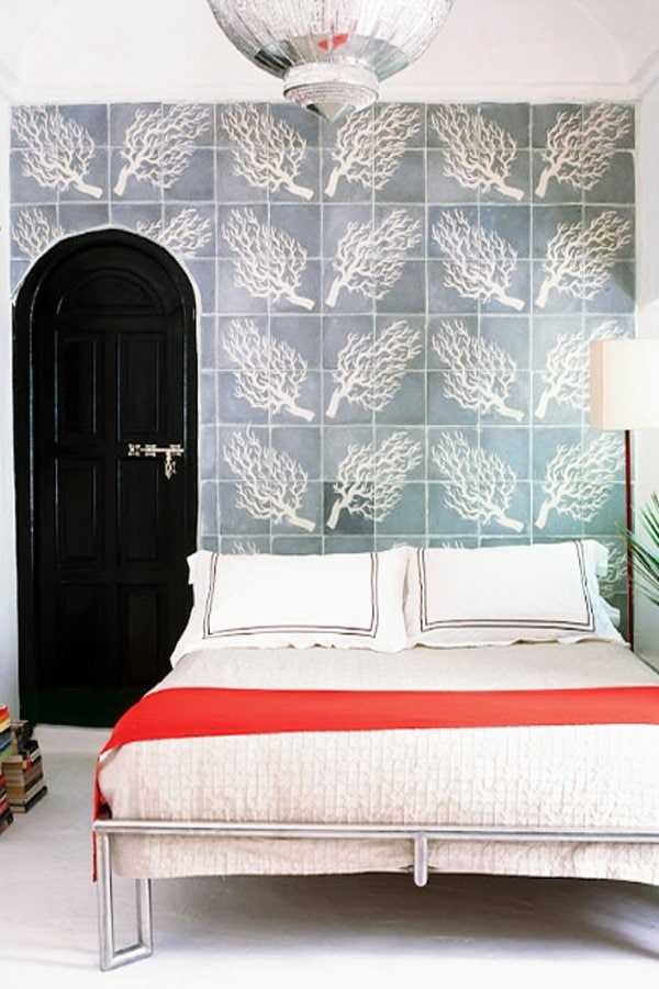 Moroccan blue and white tiled wall in a bedroom via @thouswellblog