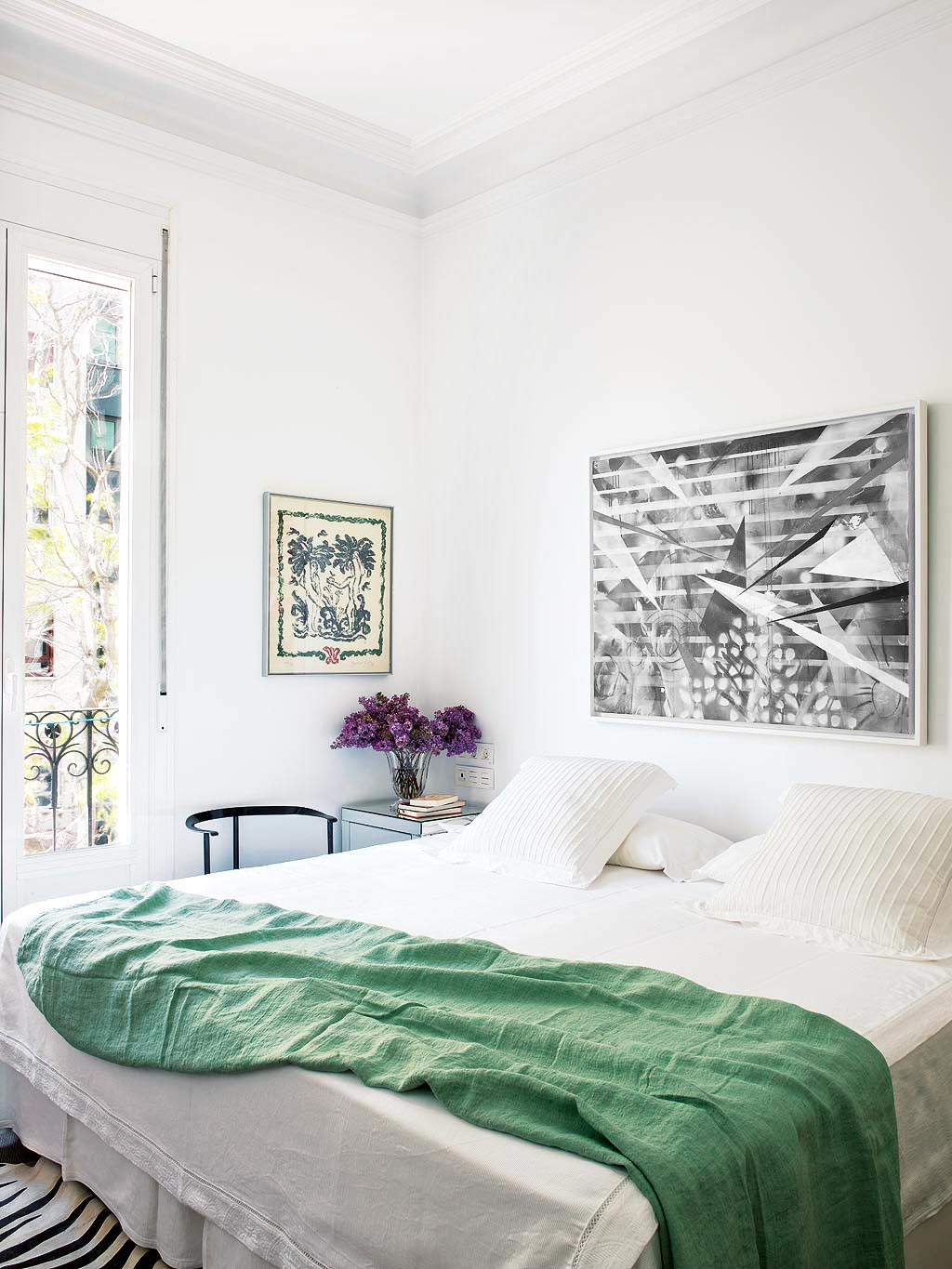 Simple bedroom with a green blanket via @thouswellblog