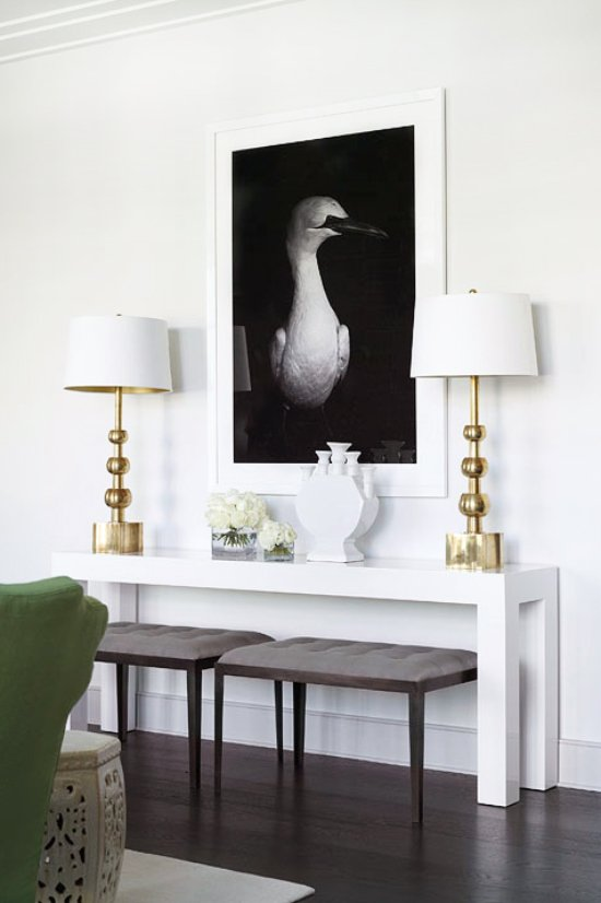 White Parsons console with a pair of sculptural gold table lamps on Thou Swell @thouswellblog