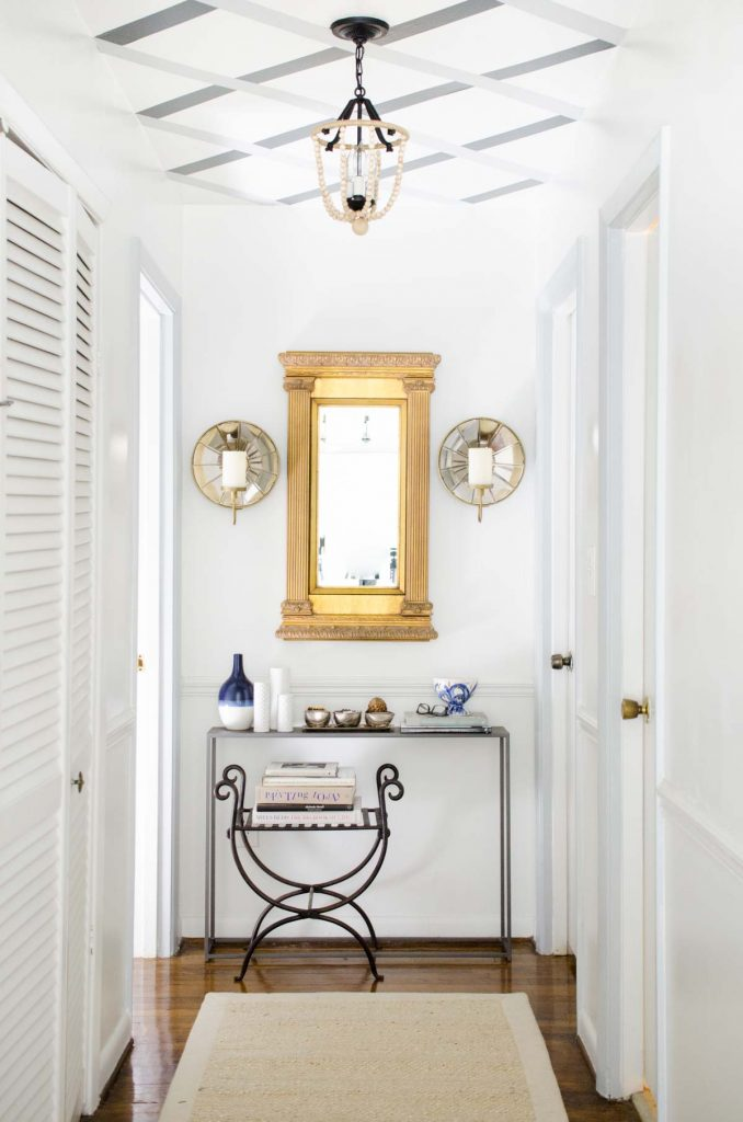 Hallway makeover with gold mirror and lattice ceiling stripes via Thou Swell @thouswellblog