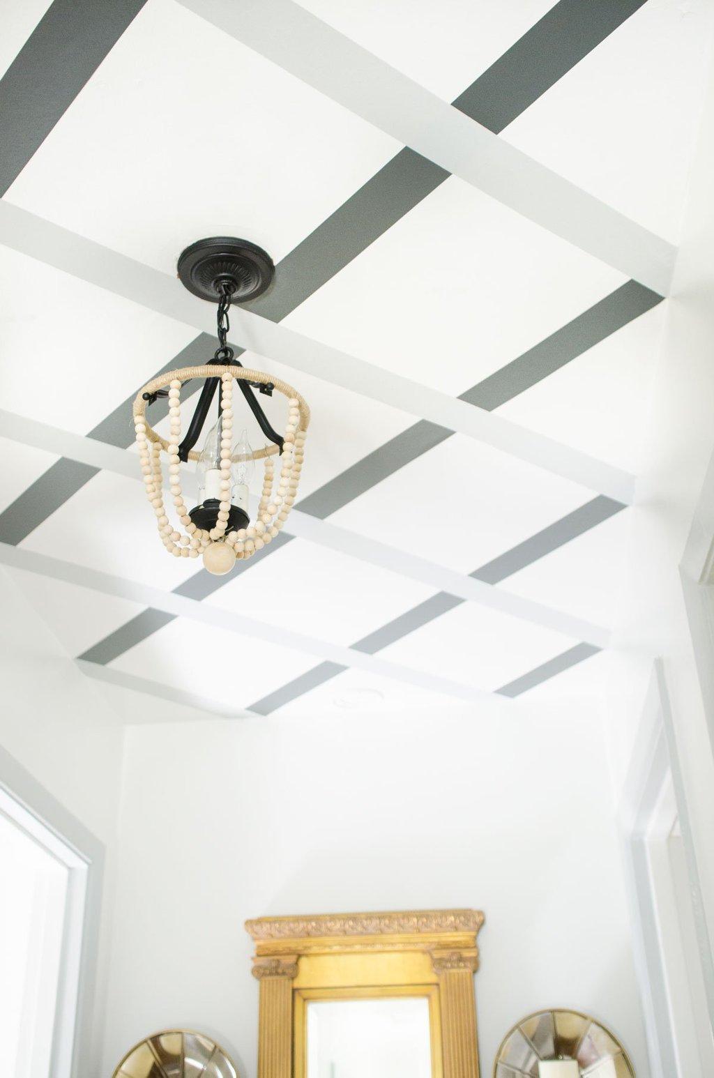DIY ceiling lattice stripes with WallsNeedLove Easy Stripe via @thouswellblog