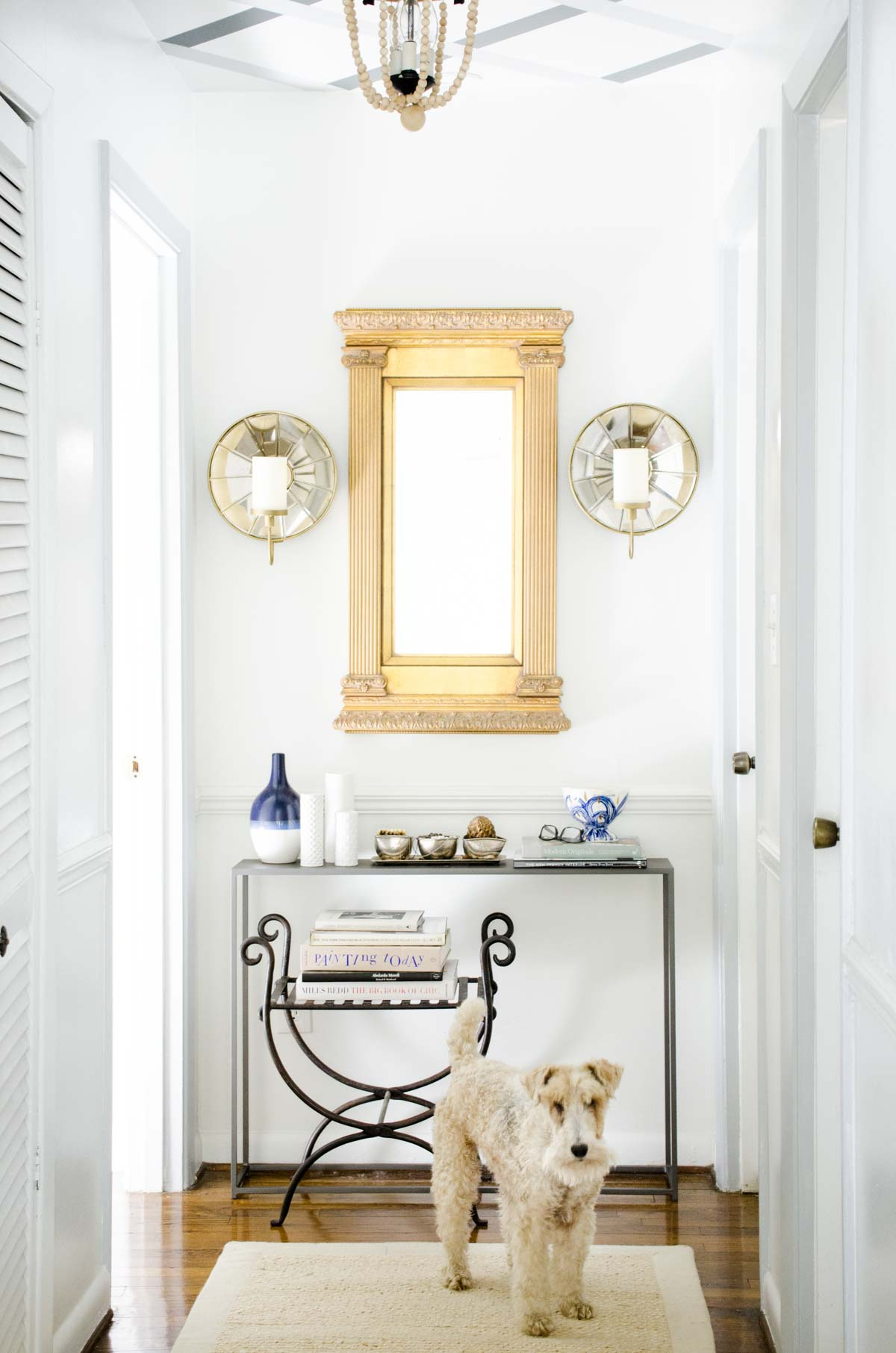 Hallway makeover with gold mirror and lattice ceiling stripes via @thouswellblog