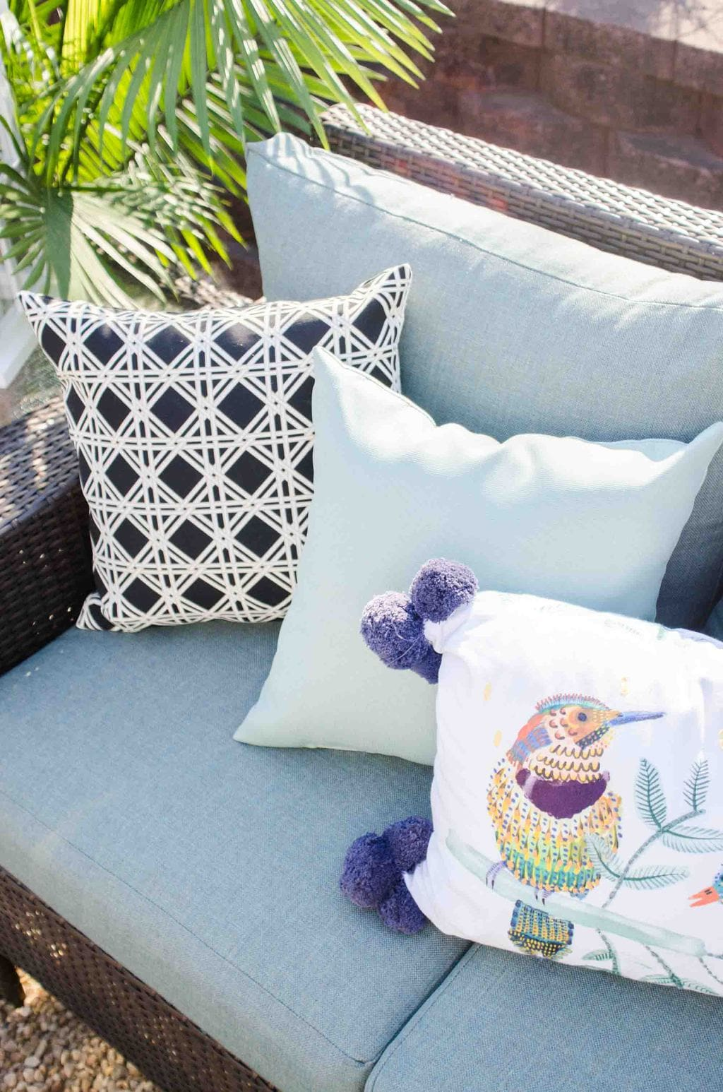 Mixed pattern blue outdoor pillows on Thou Swell