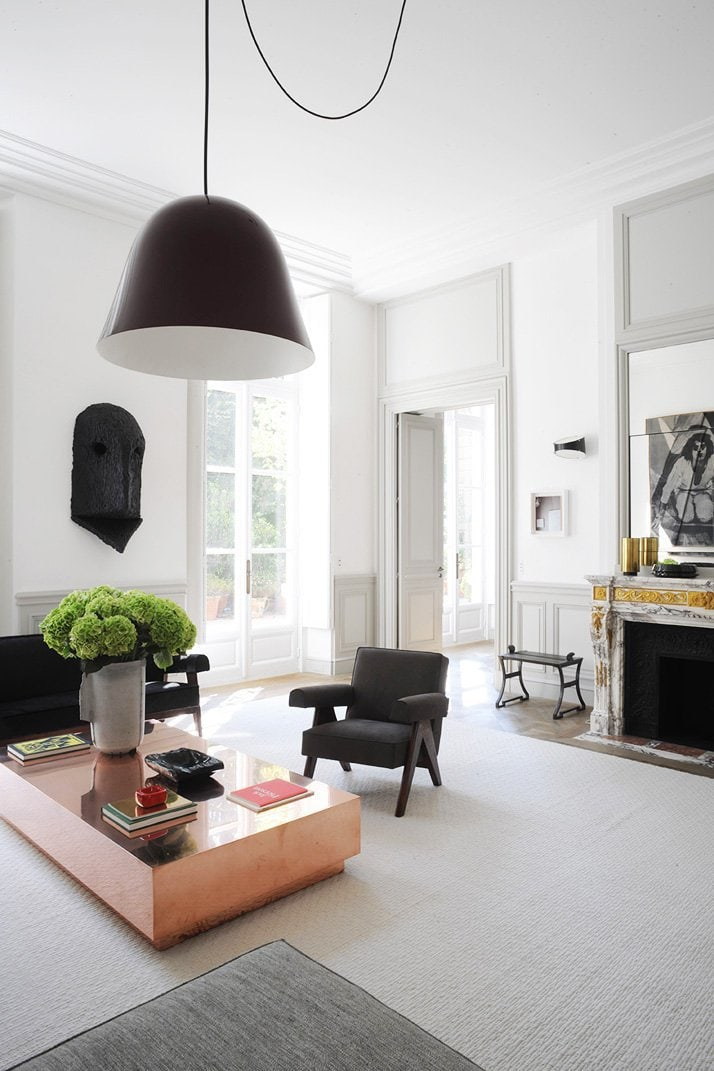Oversized black pendant light and copper coffee table in Paris living room via @thouswellblog