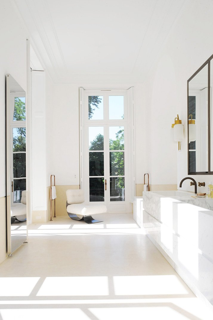 Modern white bathroom in French apartment via @thouswellblog