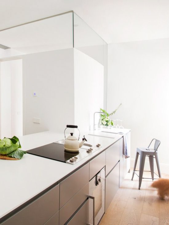 A sleek modern kitchen with slanted countertops in Madrid via @thouswellblog