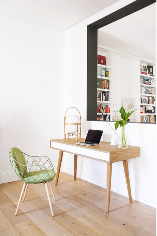 A mid-century modern desk with green chair via @thouswellblog