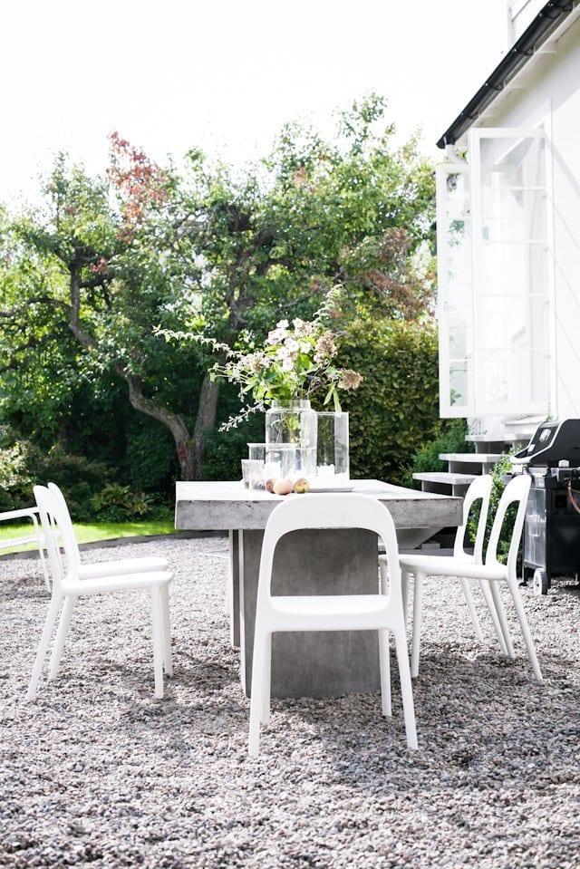 Modern gravel patio and concrete table via @thouswellblog