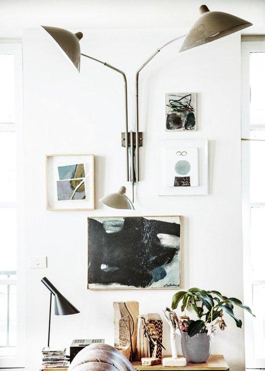 oversized modern wall sconce with three lights via thouswellblog best modern lighting