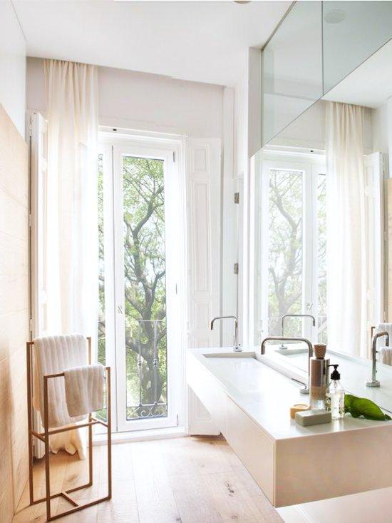 Modern bathroom with wood-clad wall and french door via @thouswellblog