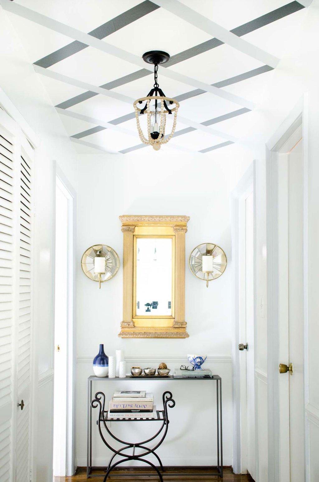 Hallway makeover with DIY striped ceiling lattice via @thouswellblog