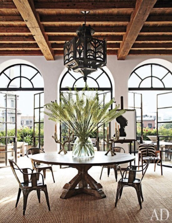 Modern rustic dining room with Tolix chairs, wrought-iron Spanish lantern, jute rug via @thouswellblog