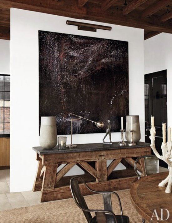 Modern rustic apartment with modern painting via @thouswellblog