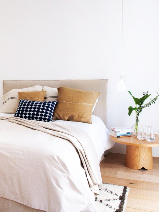 Simple neutral bedroom with wooden side table via @thouswellblog