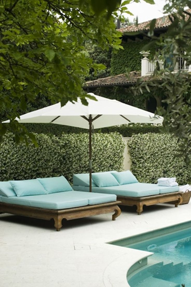Spa blue chaise lounges by a pool via @thouswellblog