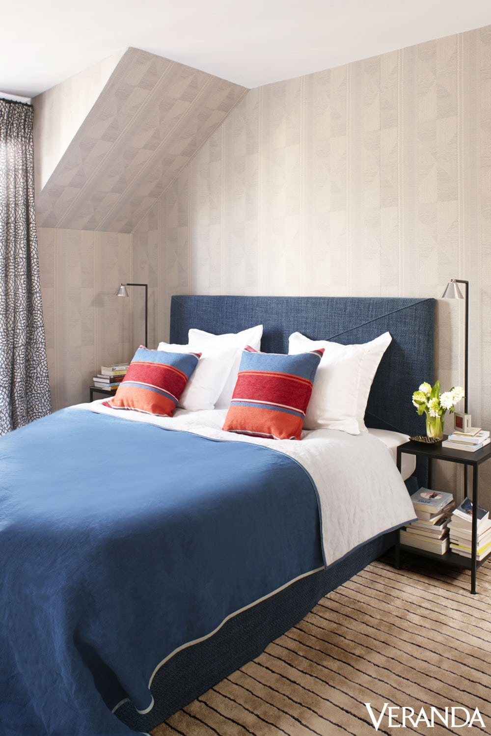 Pierre Frey's bedroom with blue bedspread and jacquard wallpaper on @thouswellblog