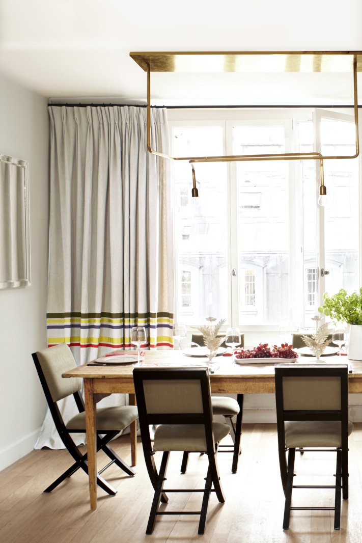Pierre Frey's dining room with modern brass chandelier on @thouswellblog