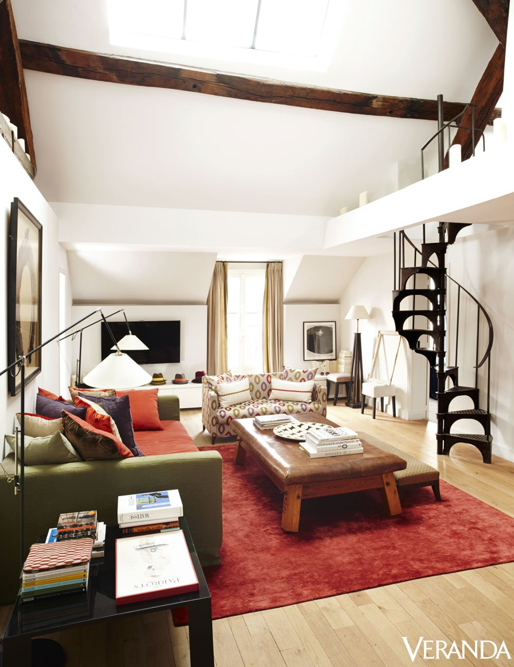 Pierre Frey's living room with bold red rug on @thouswellblog