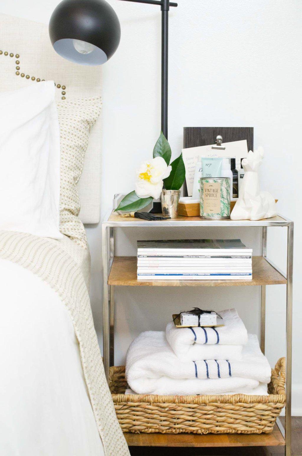Guest bedroom bedside table amenities via @thouswellblog