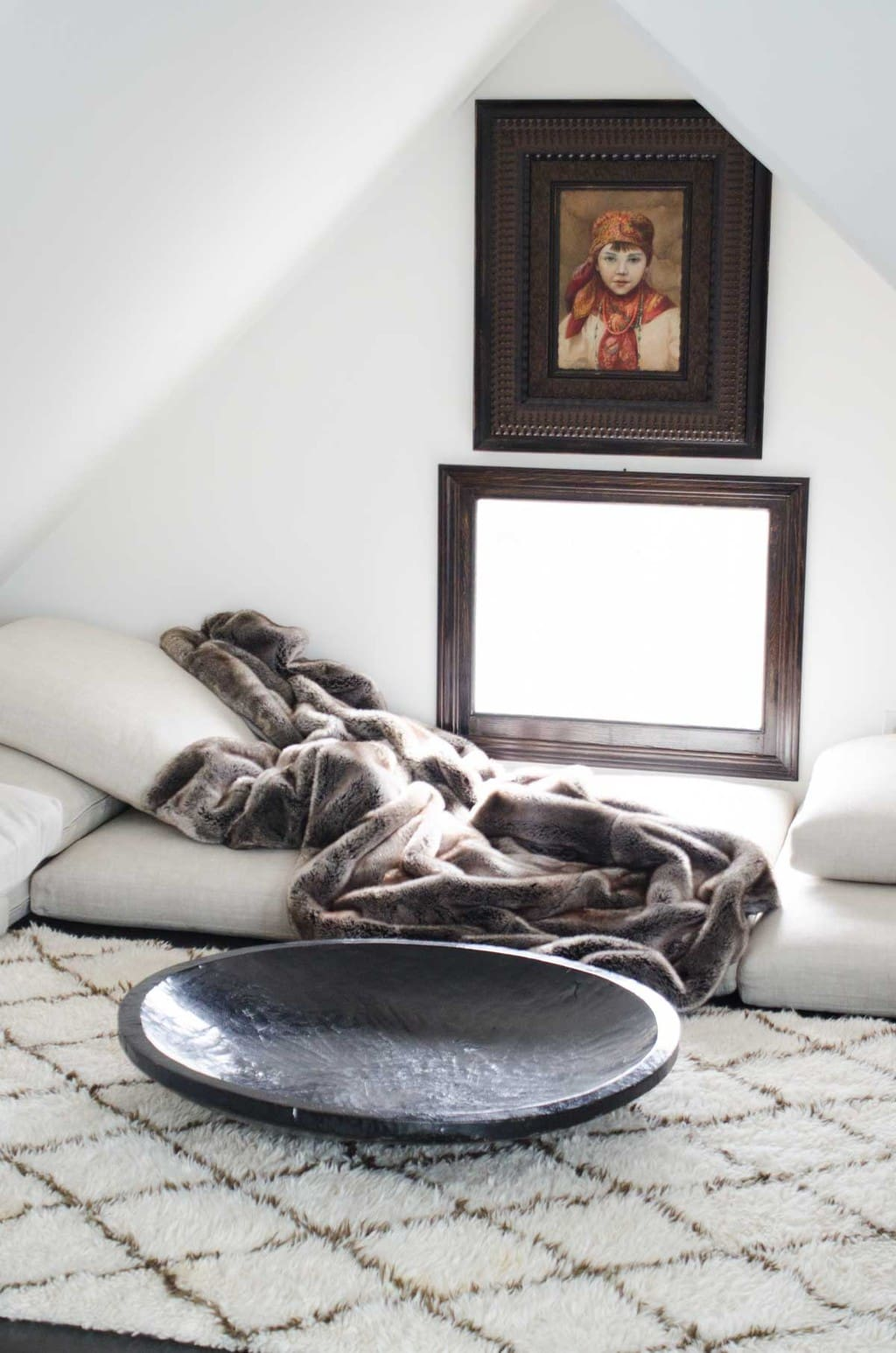 Attic lounge area with Moroccan rug via @thouswellblog