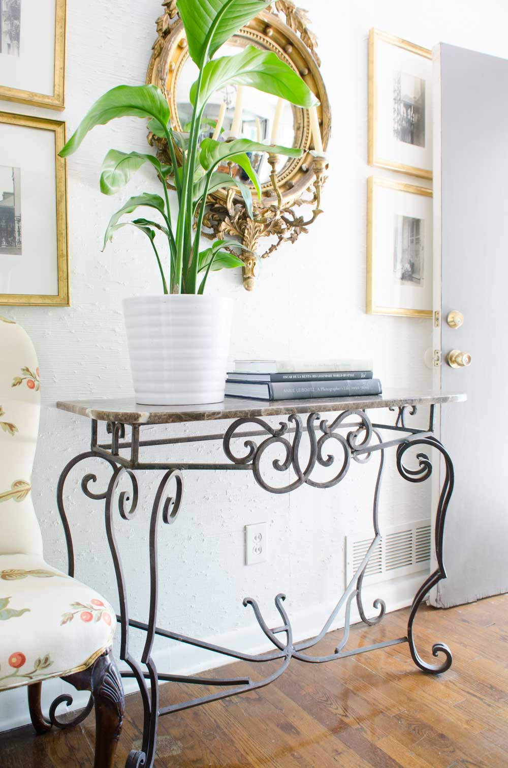 Bright entryway with gold Federal mirror and marble console table via @thouswellblog