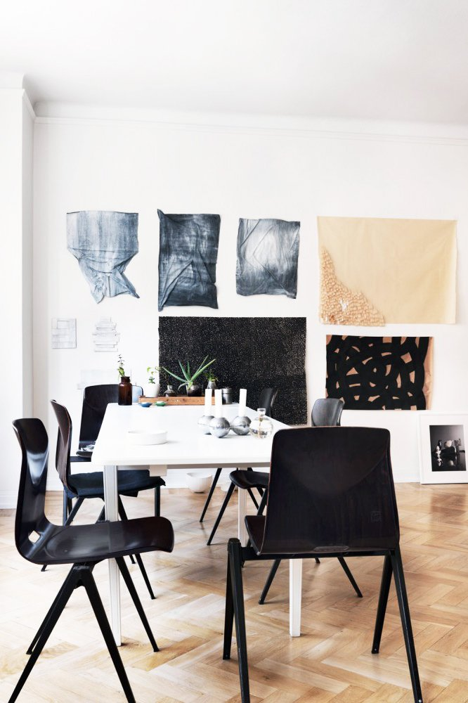 Minimal Swedish dining room with neutral decor and black chairs via @thouswellblog