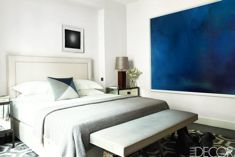 Contemporary bedroom with large blue modern art via @thouswellblog