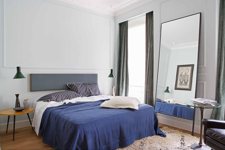 Modern bedroom with blue bedspread and floating headboard via @thouswellblog
