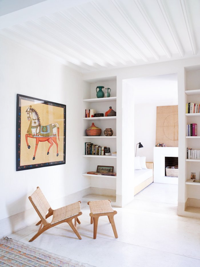 Moroccan living room with white floors and modern furniture via @thouswellblog