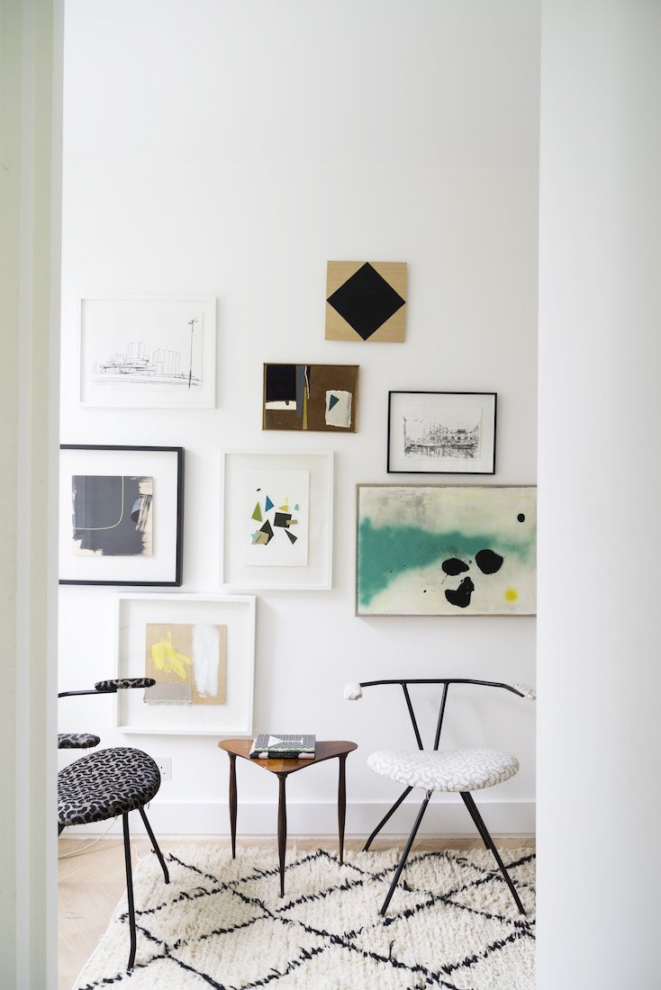 Modern gallery wall with accent chairs via @thouswellblog