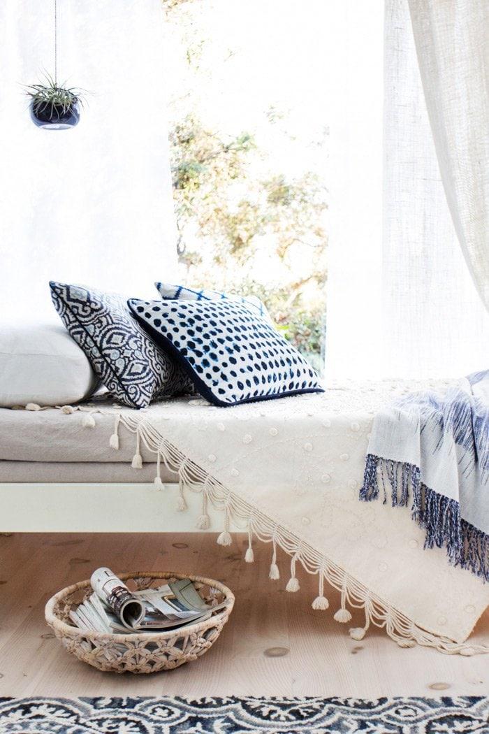 Sun room daybed with tassel decor via @thouswellblog