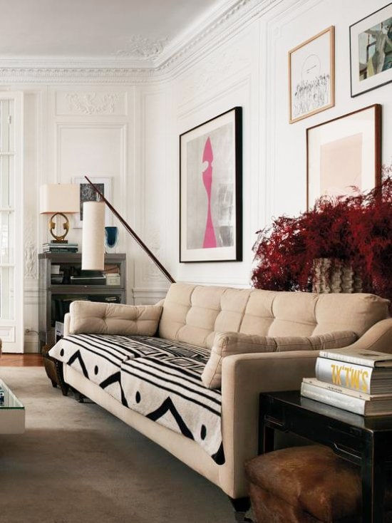 Modern sofa with vintage textile in Parisian home via @thouswellblog