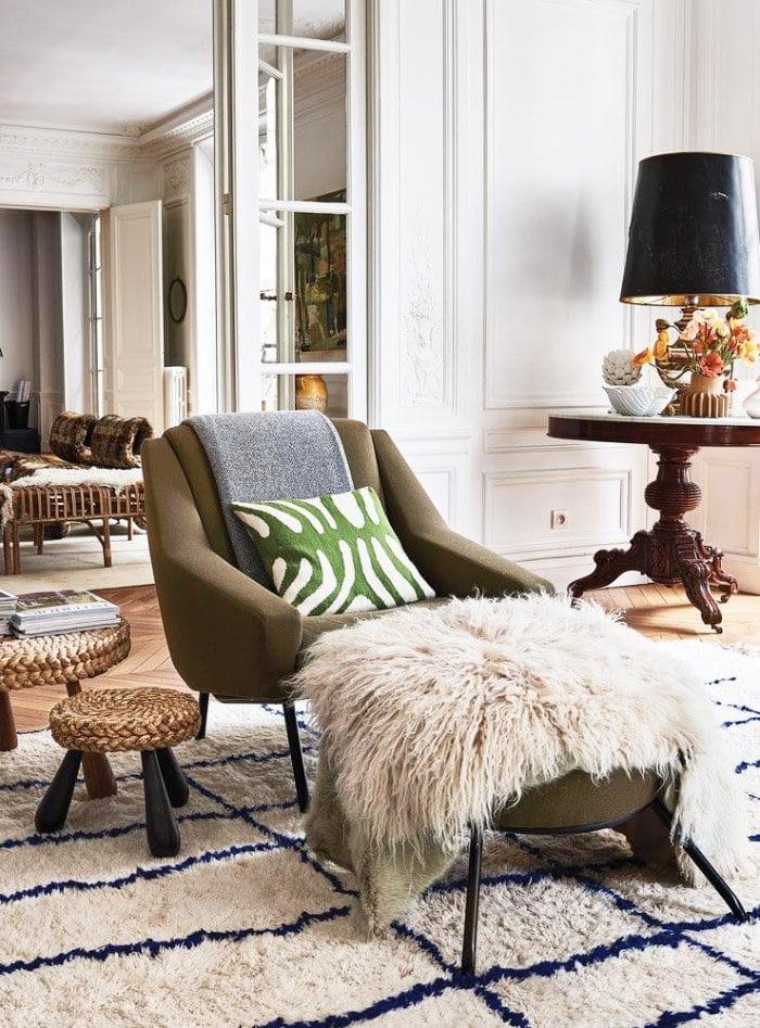 Modern armchair with sheepskin and Moroccan rug via @thouswellblog