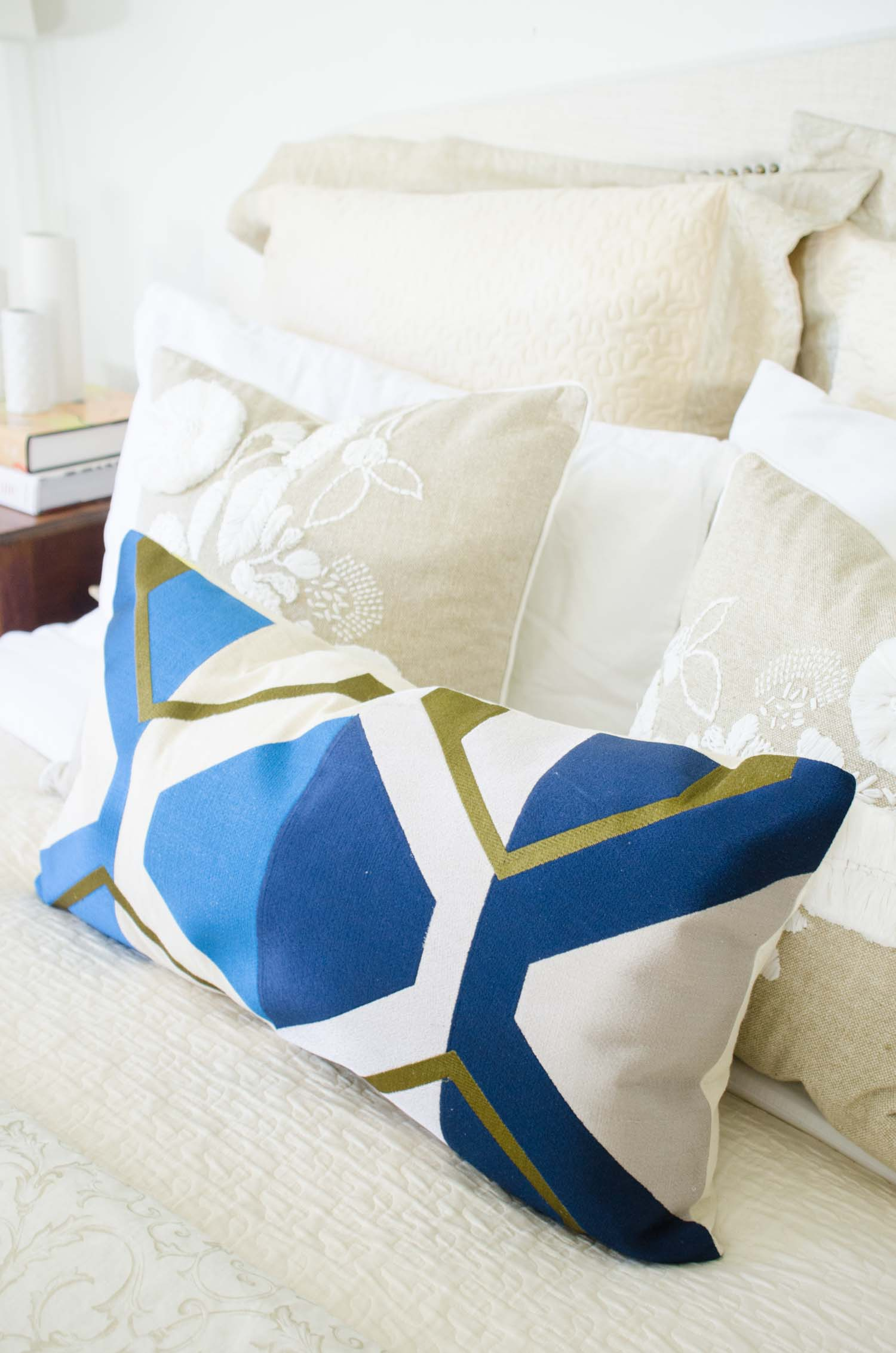 Traditional neutral bedroom with blue lumbar pillow via @thouswellblog