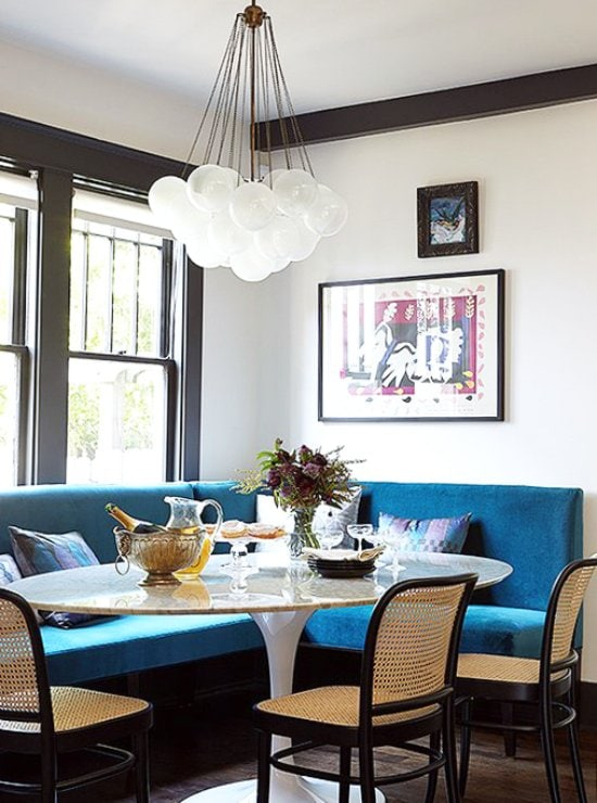 Teal banquette with modern pedestal dining table via @thouswellblog