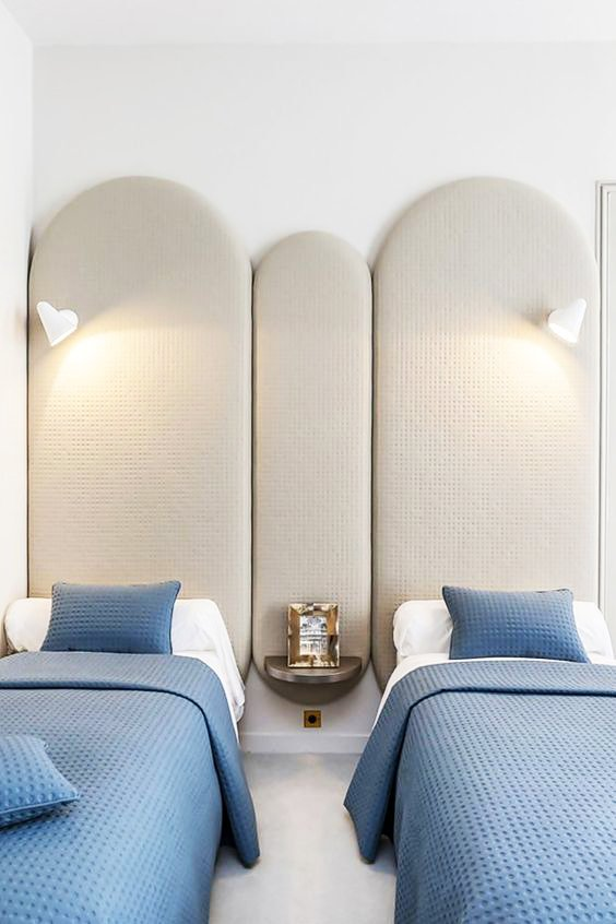 Blue and white bedroom with twin beds and upholstered headboard via @thouswellblog