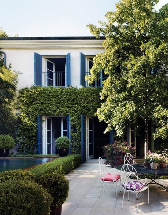 Lush backyard patio with French doors and boxwood-lined pool via @thouswellblog
