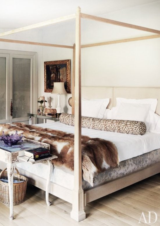 Cozy modern bedroom with poster bed and fur throw via @thouswellblog